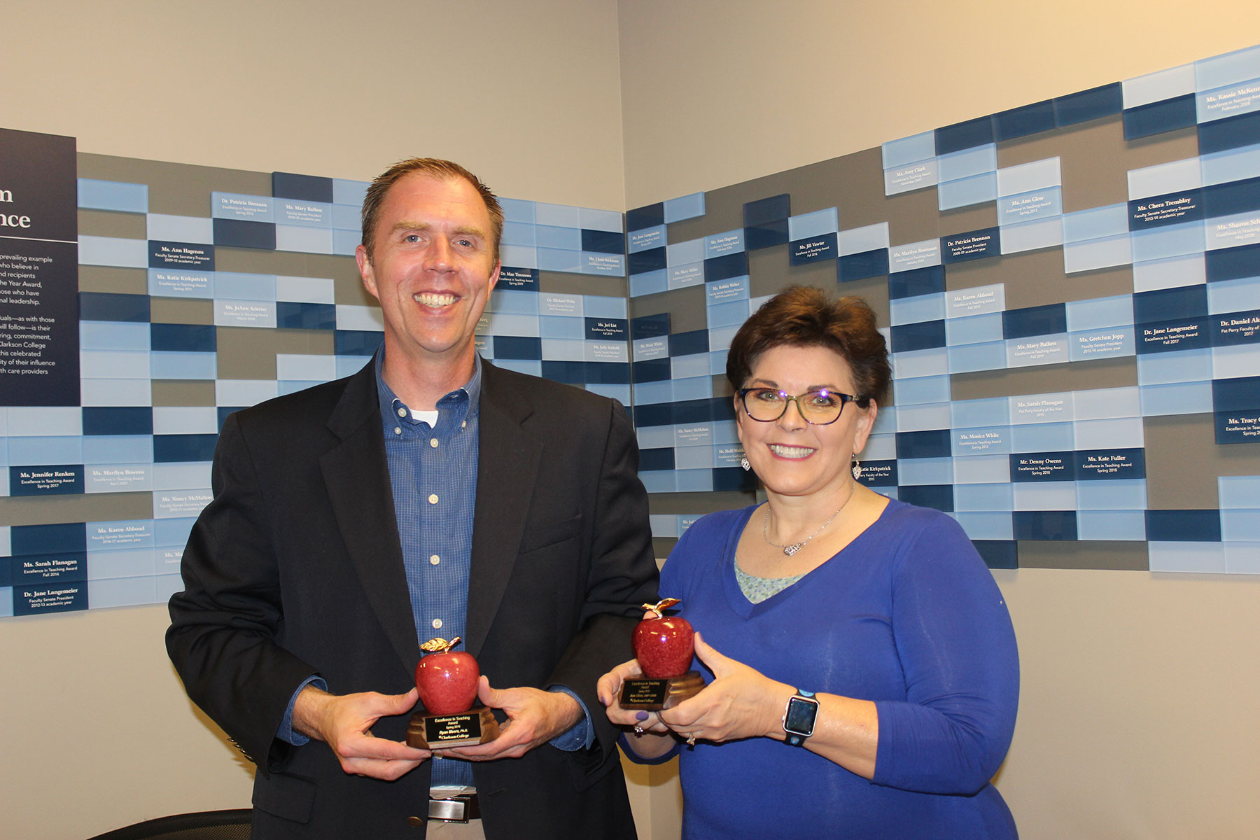 Apple award recipients Ryan Meers, Ph.D., and Ann Glow, DNP, CRNA.